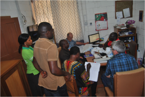 Father Anselm and his Cooperative Inquiry Group in his office at Pax Herbals