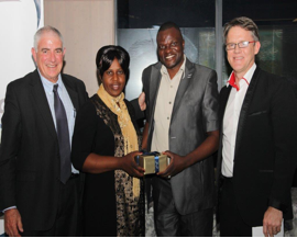 Ezekiah Benjamin and his wife receiving a  gift from Da Vinci Institute of Technology Management  during graduation dinner South Africa (2014)